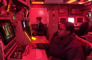 In the Arabian Gulf in 2003, Technician Seaman Apprentice Jaqueline Jackson operates the SLQ-32 console aboard the aircraft carrier USS Nimitz (CVN 68).