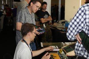 Eric Schlaepfer demonstrates his MOnSter6502 processor. Photo by Erik Klein