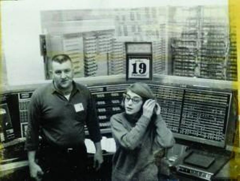 Margaret Hamilton and colleague in front of the XD-1 AN/FSQ-7 SAGE prototype computer system, 1962.