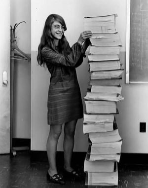 Margaret Hamilton with Apollo on-board flight software listings, ca. 1969.