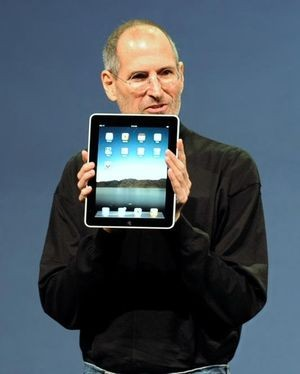 Steve Jobs showing off Apple's iPad