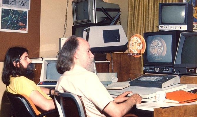 Alvy Ray Smith (left) And Ed Emshwiller at NYIT, 1979. Note the floating Sunstone face, an accidental double exposure caused by someone kicking the camera.