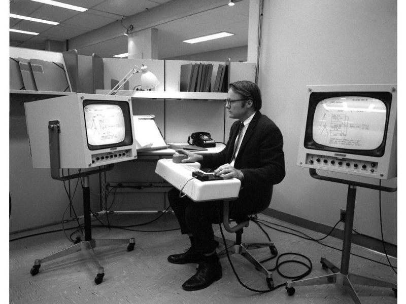 Hardware wizard Bill English with several ergonomic setups for the oNLine System (NLS); late 1960s
