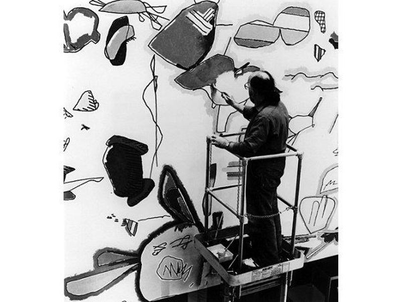 """Harold Cohen coloring the forms produced by the AARON drawing """"Turtle"""" at the Computer Museum, Boston, MA, ca. 1982. Collection of the Computer History Museum, 102627459."""