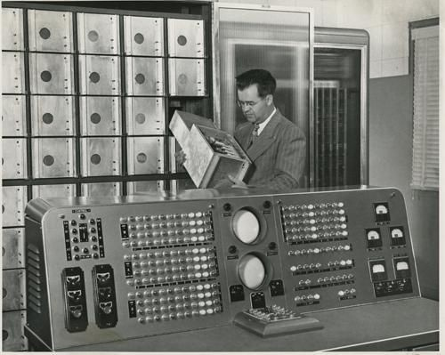 Harry Huskey examining one of SWAC's Williams Tube memory units, tubes often rendered useless by lint.