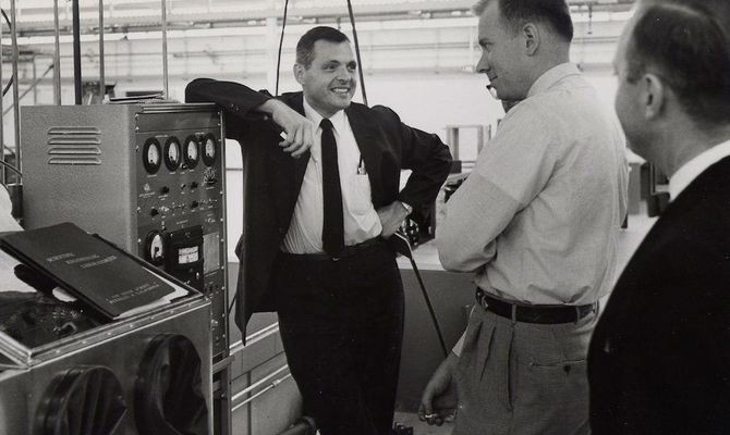 Demonstrating a new model of assembly equipment, ca.1964