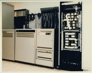 SETI equipment at DSS13, Goldstone, California, consisting of (Left to Right) a power conditioner, VAX 11/750, tape and disk drives, and the MCSA 1. CHM# 102657160/Courtesy of NASA Ames