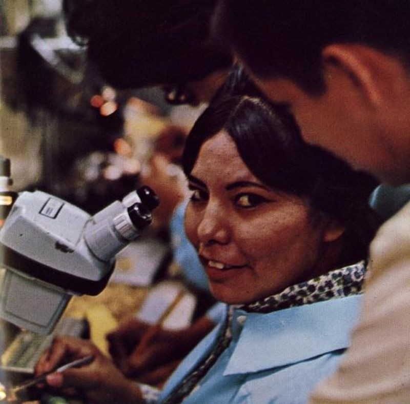 Figure 6: Navajo woman at microscope in fabrication laboratory