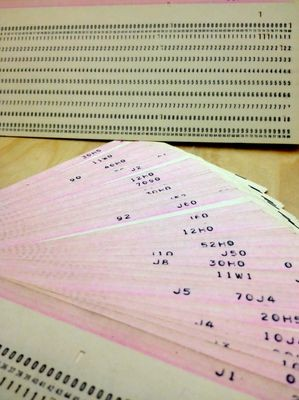 Punched cards could have their contents printed on the top edge for easier identification. In 1962, IBM still used square corners for their standard punched card stock.