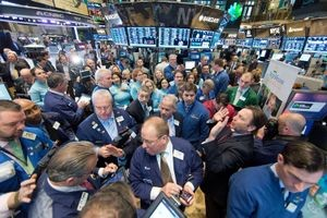 The open outcry system in action at the NYSE.
