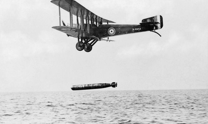 Sopwith Cuckoo bomber (piloted) launching a torpedo, circa 1918. Developed in the 1860s by Robert Whitehead, self-propelled torpedoes initially had only simple guidance systems for keeping a constant course and depth. By WWII they could home in on targets using sonar. Credit: © IWM (Q 69295)