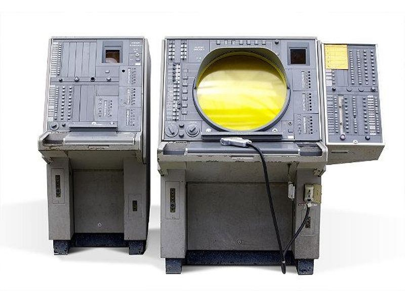 SAGE director console, 1958. This user console showed all activity in the air space assigned to it. Operators could request information about objects that appeared and use the light gun to assign identification numbers to displayed aircraft.