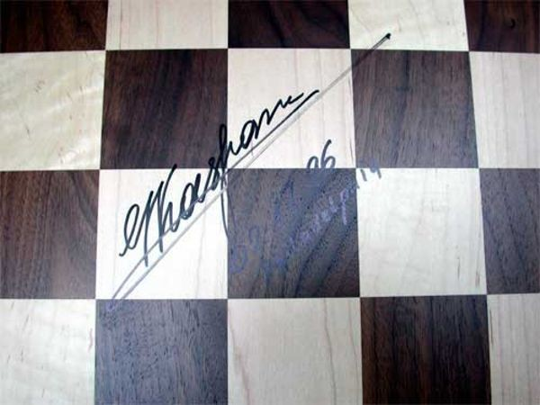 Close-up showing Kasparov signature of chess board and pieces used in the