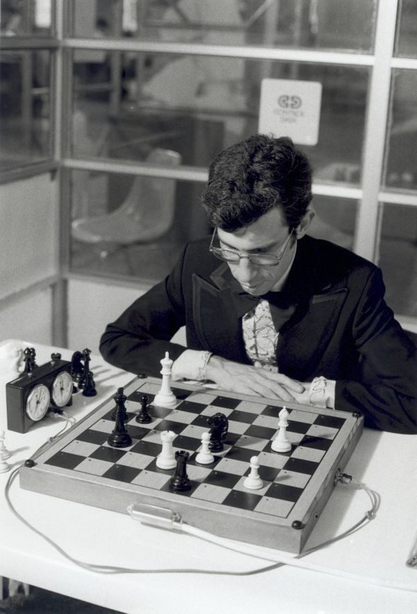 International Master David Levy ponders next move against CHESS 4.6 running on a CDC Cyber 176 supercomputer in Toronto