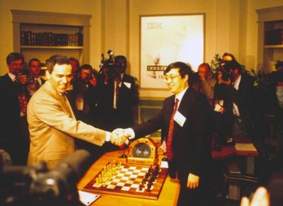 Garry Kasparov shakes hands with Feng-Hsuing Hsu at game 1 of 1997 Deep Blue vs. Kasparov re-match in New York City, New York