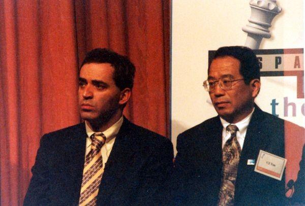 Garry Kasparov and Deep Blue project manager C.J. Tan at the 1997 Deep Blue vs. Kasparov post-match press conference