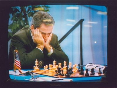 Garry Kasparov focuses intensely on his position in Game 6 of the Deep Blue vs Kasparov match in Philadelphia, Pennsylvania