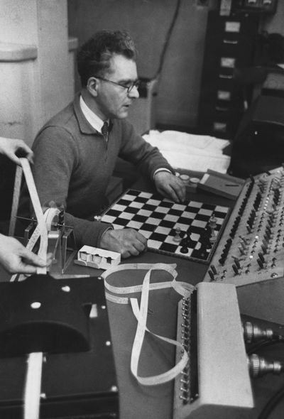 Dr. Dietrich Prinz loading chess program into a Ferranti Mark I computer