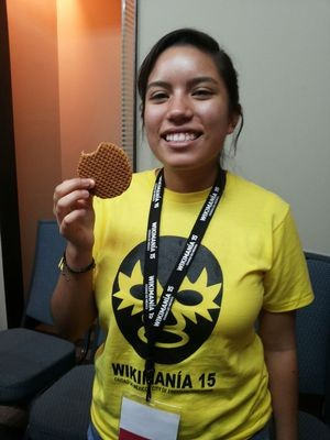Attendee eating a Stroopwafel at Wikimania 2015, Mexico City