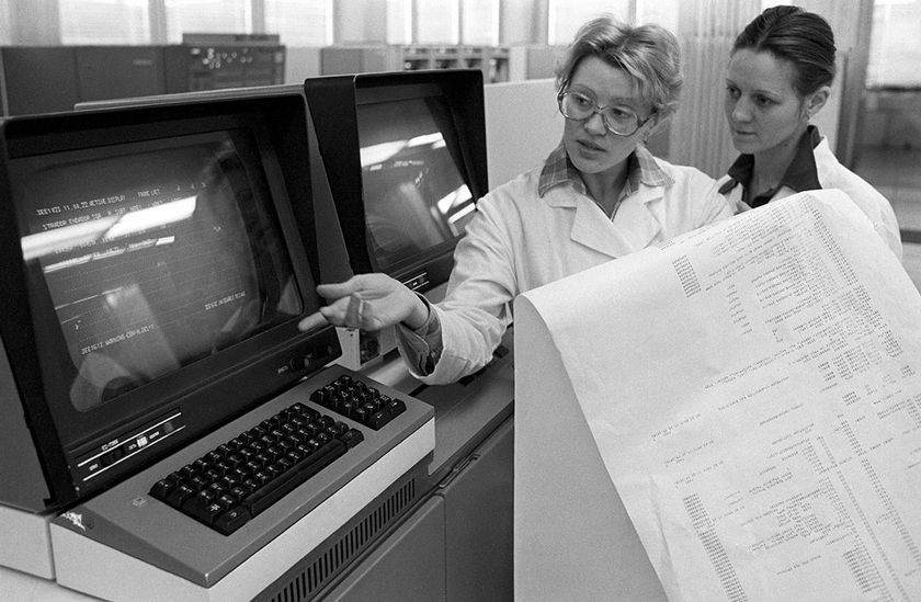 Engineers with numerical printout, October 12, 1981