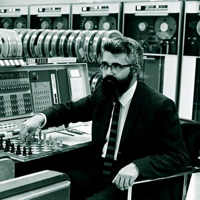 John McCarthy, artificial intelligence and timesharing pioneer, playing chess at Stanford's IBM 7090