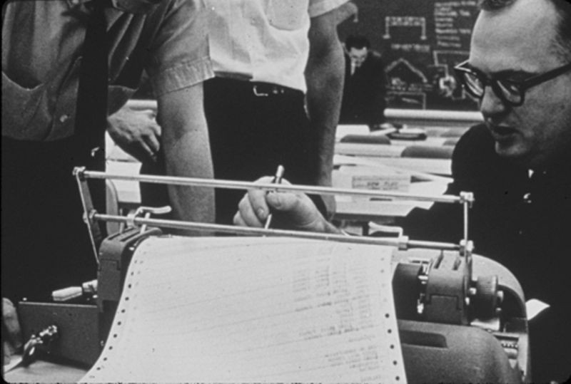 Students interacting with the PDP-1 via its Soroban console typewriter