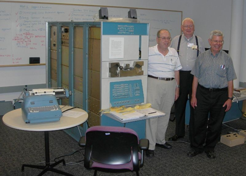 "From left to right: Alan Kotok, Peter Samson and Stephen ""Slug"" Russell in front the Computer History Museum's restored PDP-1 computer system."