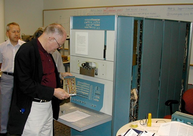 Gordon Bell in front of the restored DEC PDP-1