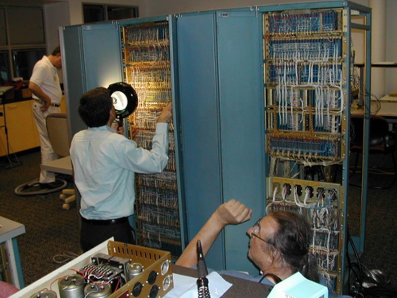 Joe Fredrick and Lyle Bickely inspecting PDP-1 backplane as part of the PDP-1 restoration project