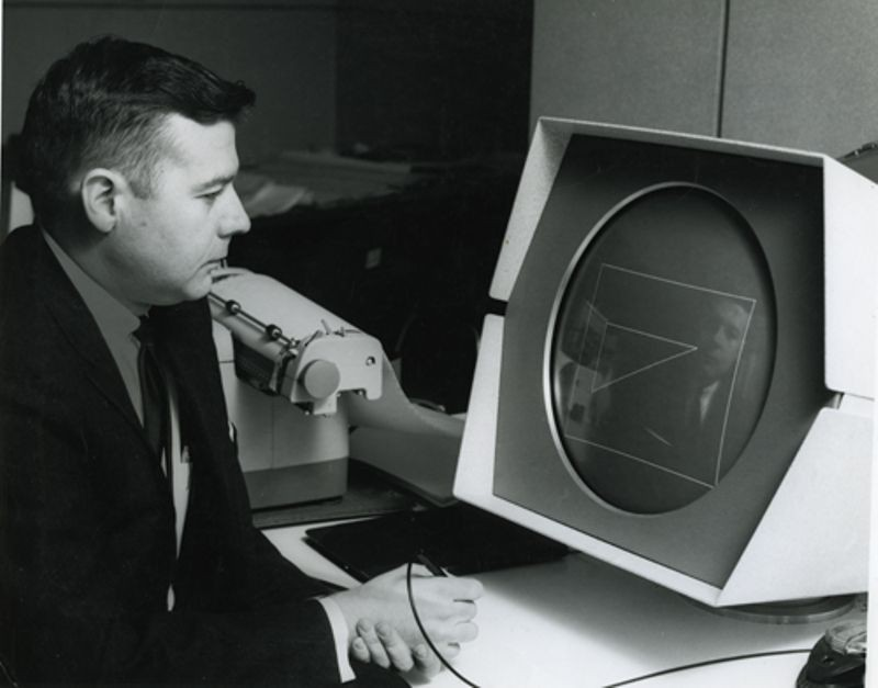 User interacting with an early Computer Aided Design (CAD) program running on a PDP-1 computer