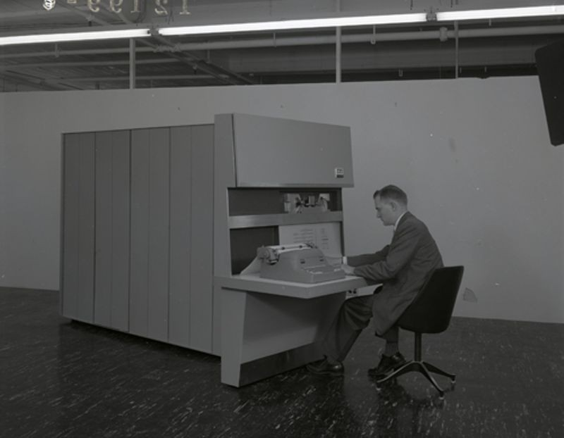 Man at console of an ITT PDP-1 (ADX 7300)