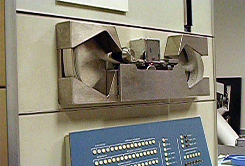Paper tape being read through PDP-1 tape reader during the Computer History Museum PDP-1 restoration project