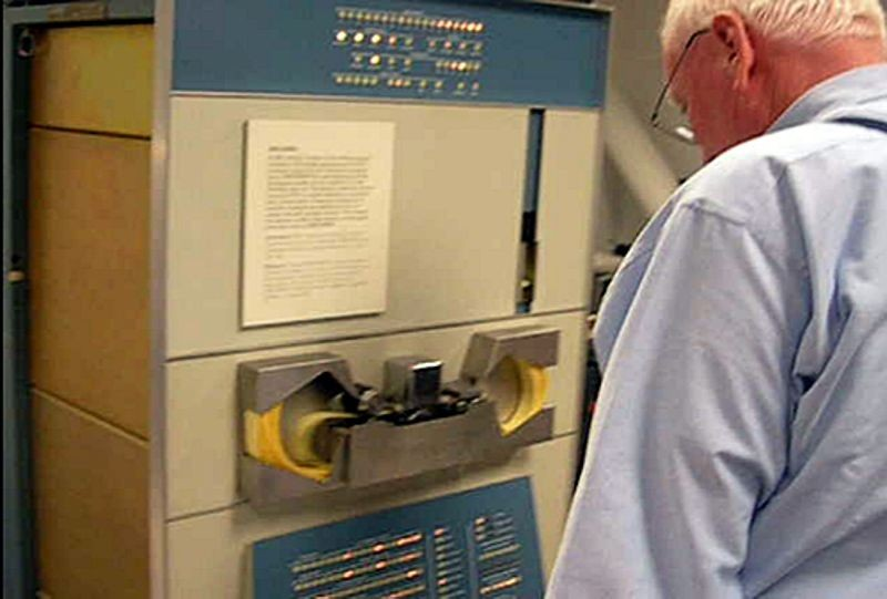 Peter Samson loading music program through PDP-1 tape reader during the Computer History Museum PDP-1 restoration project