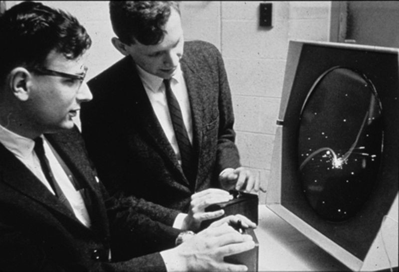 Dan Edwards (left) and Peter Samson playing Spacewar! on the PDP-1 Type 30 display.