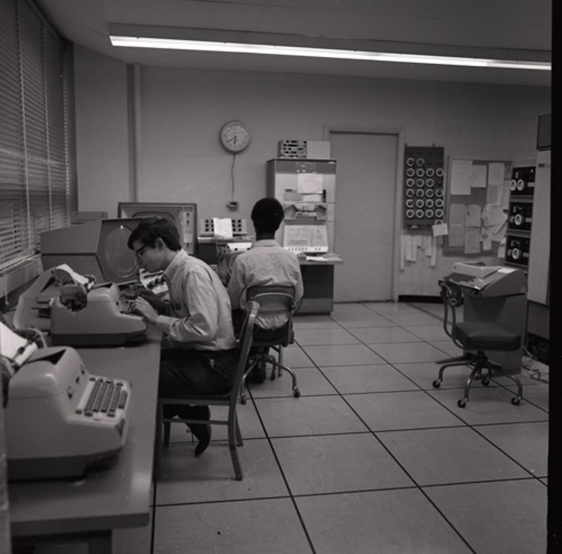 Two men at PDP-1 at MIT