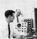 Max Palevsky (standing) and Robert Beck, in the lab