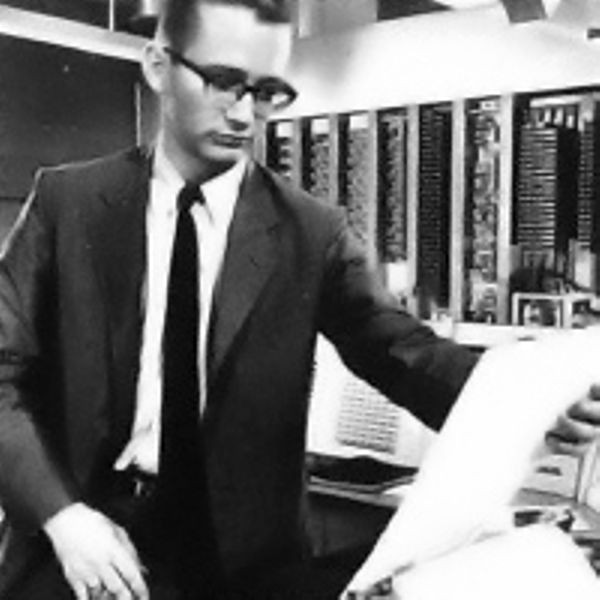 Harrison Dit Morse, one of the programmers, looks at a script being printed on the TX-0